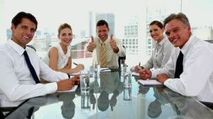 stock-footage-laughing-businessman-giving-thumbs-up-with-colleagues-around-in-a-meeting-room